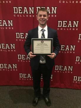 NSLS student posing with a diploma