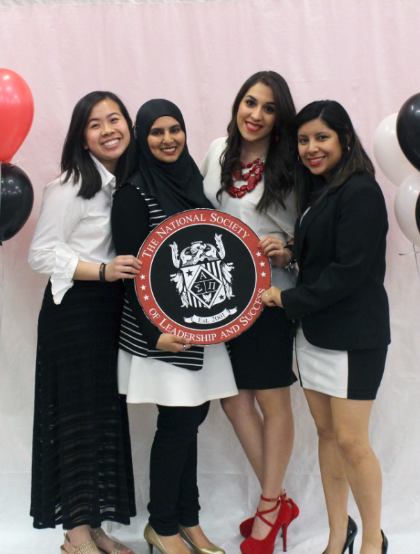 Students holding the seal of NSLS